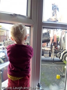 Watching the lorry tipping.